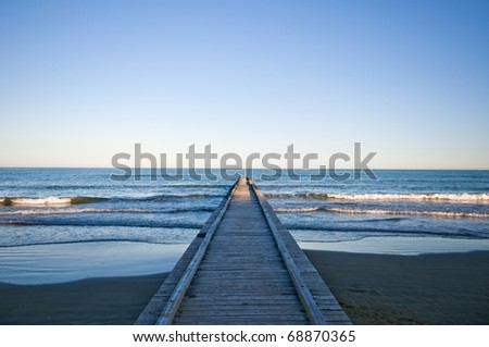 the beach in Lido di Jesolo , Italy during the sunset - stock photo