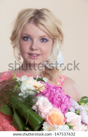 The beautiful girl with a bouquet flowers #147537632