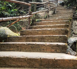 The brick stairs and wooden handrails were built on mountain trails and hiking trails for a natural study perspective. Tourist