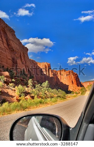 The car on road to canyon Burr in state of Utah