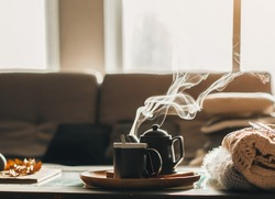 the concept of enjoying coffee at home, spending time at home