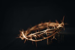 The crown of thorns of Jesus upon holy bible on black  background with copy space, can be used for Christian background, Easter concept