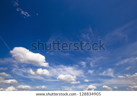 the dark blue sky on which there are white clouds