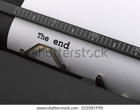 """The end"" message typed by vintage typewriter."