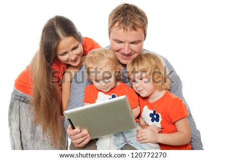 The family looks the monitor - stock photo