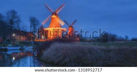 the famous two Windmills of Greetsiel at North Sea in East Frisia,lower Saxony,Germany