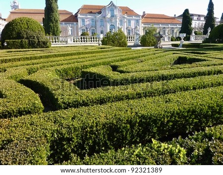 The garden with the ballroom wing of the Queluz palace in Portugal