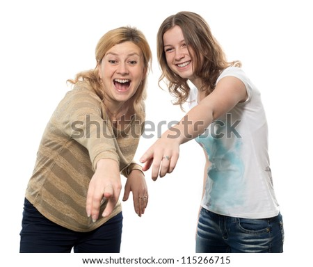 The girl and the woman specify a finger