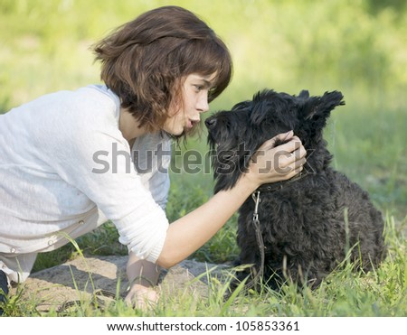 The girl talks to a dog