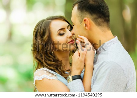 the girl that touches the face of her boyfriend and the guy wants to kiss her pretty girl #1194540295