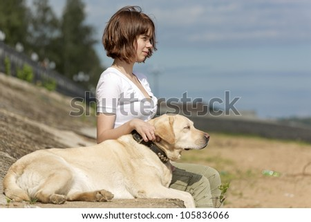 The girl with a dog sit