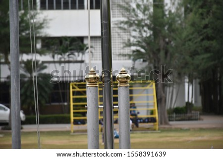 The gold colored plastic spigot is worn on two parallel poles to support the flag pole firmly.
