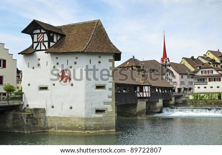 The historic town of Bremgarten, Switzerland at Summer. With the river Reuss and old wooden bridge.