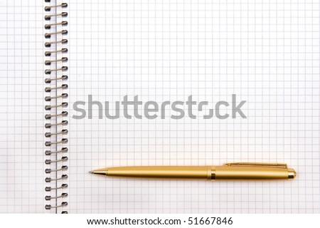 The image of the notepad and pen