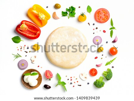 The ingredients for homemade pizza on white wooden background. Top view .