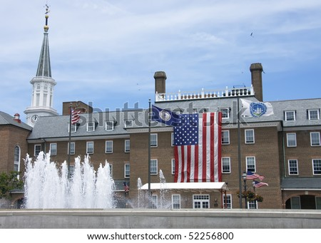the largest  American flag ever seen standing in front of the city hall  in Alexandria city, Virginia Va, USA