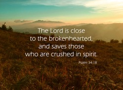 'The Lord is close to the brokenhearted and saves who are crushed in spirit' quote on nature background.