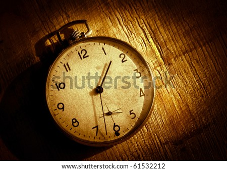 The old clock on the grunge background. High Contrast