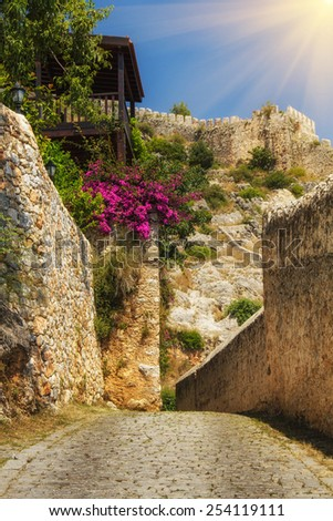 The old fortress in Alanya: paths around the fortress terrain in sunshine. Turkey. Filtered image: colorful and soft effect.