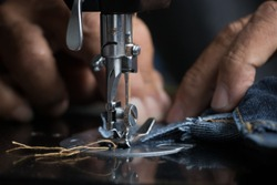 the old Tailor was sewing closeup