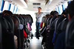 The passengers in the bus which are tourists and guide