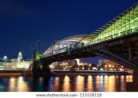 The pedestrian bridge Bogdan Khmelnitsky on night. Moscow cityscape, Russia