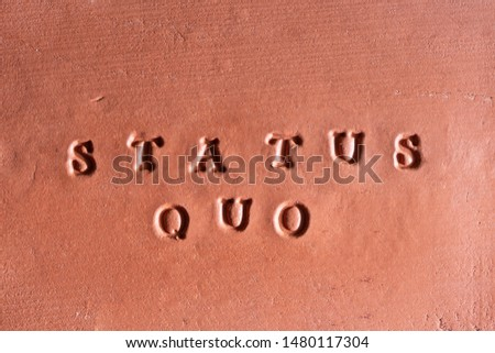 """the phrase  """"Status Quo"""" ( factual situation) written in Latin on a terracotta tablet #1480117304"""