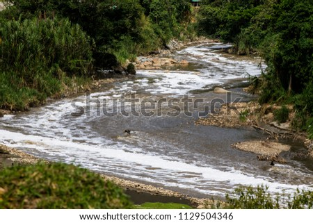 The pollution of the Medellín River, Colombia, is caused mainly by commercial and industrial companies. The majority of companies in the Aburrá Valley are connected to the public sewer network #1129504346