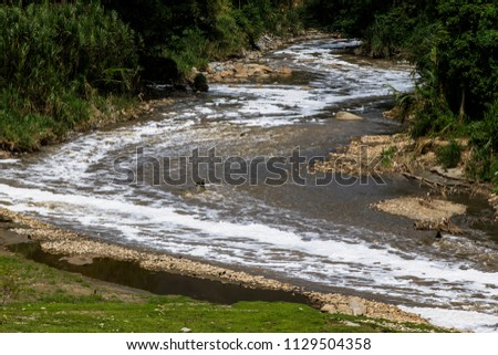 The pollution of the Medellín River, Colombia, is caused mainly by commercial and industrial companies. The majority of companies in the Aburrá Valley are connected to the public sewer network #1129504358