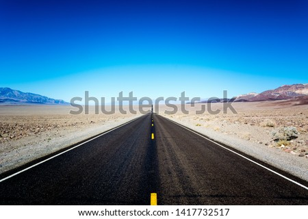 The road through death valley... Death Valley is a desert valley located in Eastern California #1417732517