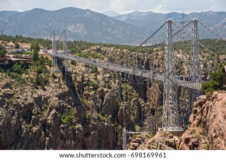 The Royal Gorge Bridge, one of the world's highest suspension bridges, crosses the canyon 956 feet above the Arkansas River and is considered one of the natural wonders of the world. #698169961