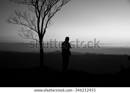 The shadow of a man standing on a hill in black and white background #346212455
