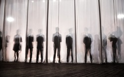 the silhouette of the men behind the curtain in the theater on stage, the shadow behind the scenes is similar to the white and black piano keys.