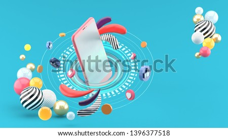 The smartphone is surrounded by like buttons and love buttons in colorful balls on a blue background.-3d rendering.