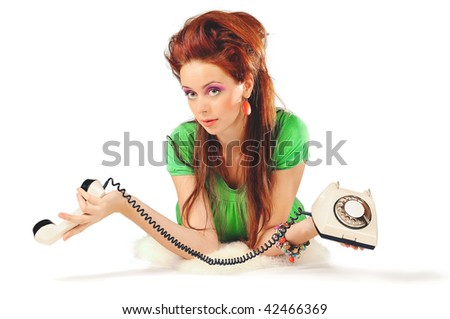 The stylish girl in a green dress is calling isolated - stock photo
