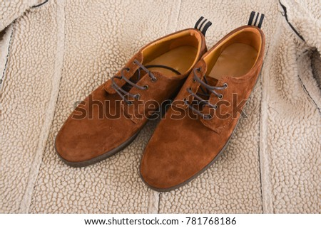 The texture and Background of beige wool fabric. With shoes  #781768186