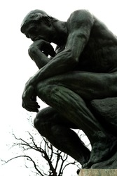 The thinker against a cloudy sky
