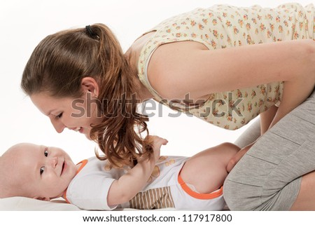 The young woman talks to the kid