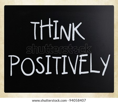 """""""Think Positively"""" handwritten with white chalk on a blackboard"""