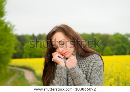 thoughtful young woman on field