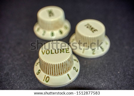 Three Aged Knobs of guitar, one of volume and two of tone.