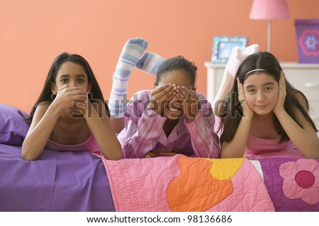 """Three girls posing with hands over mouth, eyes and ears"""