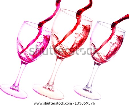 Three glasses of red wine abstract splash isolated on white background