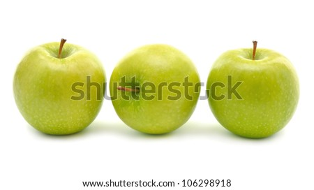 Three green apples on white background