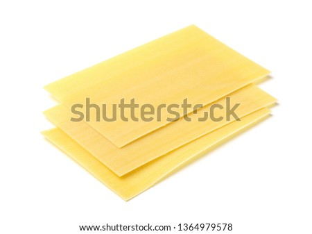 Three uncooked  lasagne sheets isolated on white