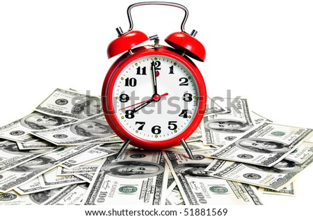 """""""Time is money"""" concept - classic alarm clock over dollars. High contrast"""
