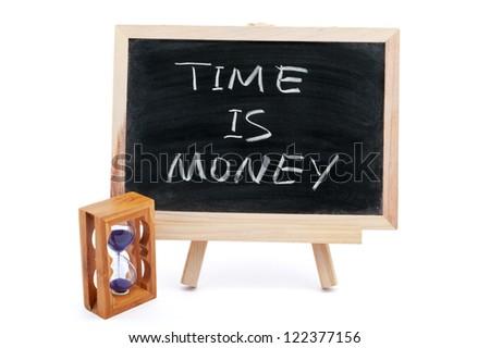 """""""Time is money"""" saying written on blackboard"""