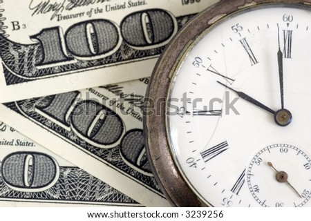 """time - money"" concept -  pocket watch on one hundred dollars background"