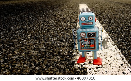 tin robot on a long road