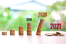 2019 to 2021, Money reduced (not saving) for your current situation (Coronavirus or COVID-19) isolated on nature background - bad economy & economical concept.